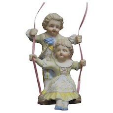 Bisque Boy and Girl Lamp Swinger Dolls