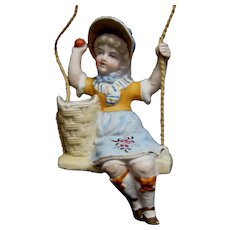 Bisque Girl Doll on Swing With Match Holder Basket