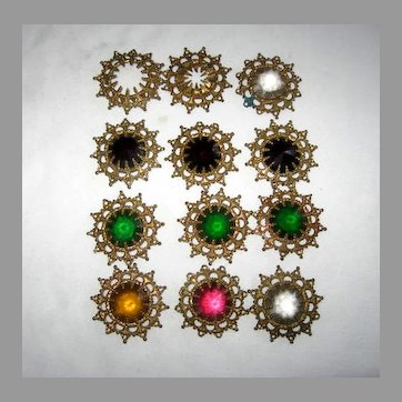 Ten old colored glass jewel crystals mounted in brass