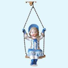 Bisque Girl Doll on Swing - Swinger