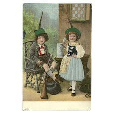 Embossed and Silk Embellished Postcard of Two German or Austrian Children with Rifle