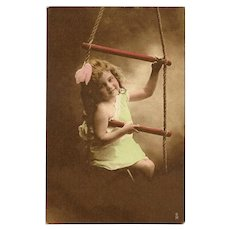 Raphael Tuck Hand Colored Photo Postcard of Young Girl on Swing - 1 of 2
