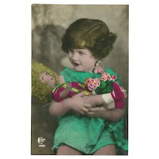 Real Photo Tinted Birthday Postcard of Girl with Doll