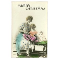 Vintage Tinted Photo Christmas Postcard of Mother and Daughter