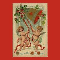 Embossed 1909 New Year Postcard of Cherubs Ringing Bell