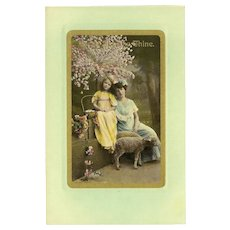 Vintage Easter Tinted Photo Postcard of Mother and Daughter with Sheep