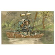 Embossed 1909 Many Happy Returns Postcard of Boy in Boat with Cat