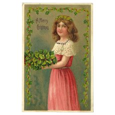 Embossed 1909 Christmas Postcard with Young Girl and Holly