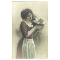 Vintage Postcard of Woman Holding Basket of Kittens