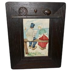 Chromolithograph of Dutch Boy and Girl in Iconographic Frame