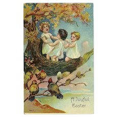 Vintage Glossy Embossed Easter Postcard Childlren in Nest