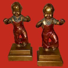 Armor Bronze Polychrome Bookends of Child by Chas. Jennings