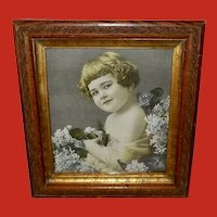 Vintage Framed Print of Young Smiling Girl with Flowers