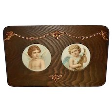 Ornate Frame with Cherub Attachments and Chromolithographs