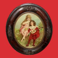 Chromolithograph of Girl and Boy with Mandolin Oval Acorn Frame