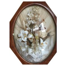 Antique French anniversary silk flowers in wooden frame
