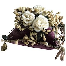 Beautiful rich purple velvet cushion with fabric roses and wax orange flowers