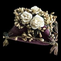 Magnificent wedding purple velvet cushion with fabric roses and wax orange flowers