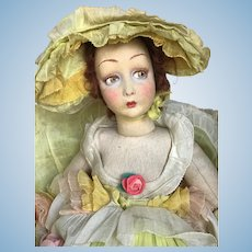 Antique Lenci lady in yellow outfit