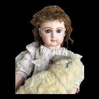 Beautiful Bebe Jumeau size 11 with light brown eyes