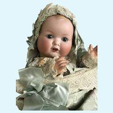 German bisque head baby in beautiful silk christening pillow