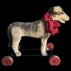 Beautiful Steiff Hound dog on wooden wheels