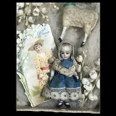 All bisque  mignonette doll and sheep in box