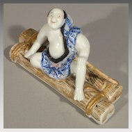 Japanese Arita Porcelain Okimono - Man on Raft