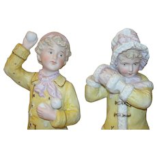 Rare Pair of tall Antique Heubach Figurines - Boy & Girl Snowball fight!