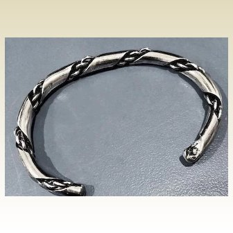 Vintage silver bracelet; heavy tube with twister chain twisted in the tube