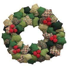 Handmade: Green, Red, White: Holly Leaf wreath: Red Berries.  Wire frame and stuffed wreath.  25 inches by 6 inches