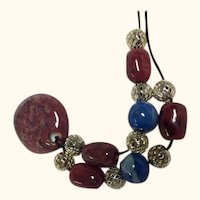 Artisan Necklace: African Kazuri Beads: Silver plate filagree and toggle: