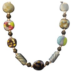 Kazuri Artisan Necklace: 9 African Kazuri beads: Black lave beads; Silver rounds and barrels; 22 inches