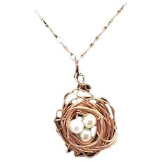 Artisan; Copper nest necklace: Three pearl bead eggs: Copper woven nest: Copper necklace:19 inches