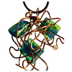 Artisan Necklace: A copper cloud of wire and three aqua squares: 24 inches