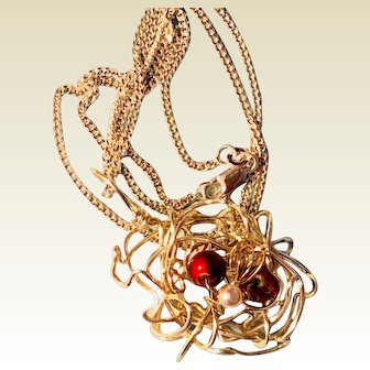 Artisan necklace: A Christmas nest with three eggs: cranberry and pearl. 21 inches