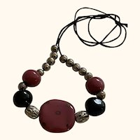Rose and black Kazuri beads: silver rounds: adjustable on a black cord: 22 inches