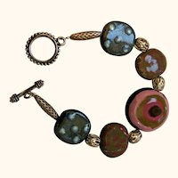 Artisan Bracelet: Kazuri: 5 pottery discs: silver filigree beads: toggle clasp: 8.25 inches