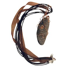 Artisan Necklace:  Petoskey Stone: Lake Michigan: wrapped in copper: multi ribbon necklace : 24 inches