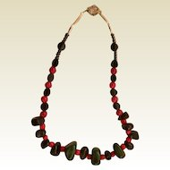 Artisan Necklace: Black, Red, Green stones: 22 inches: liver longs: fancy toggle clasp