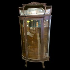 Oak curved glass china cabinet hooded top