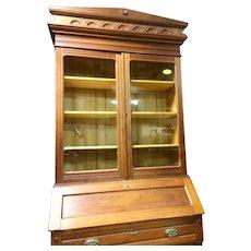Walnut secretary with bookcase top.