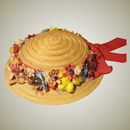 Child-size Straw Hat With Fanciful Raffia Straw Floral Decorations