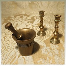 Group of Display Items: Candlesticks and Mortar + Pestle
