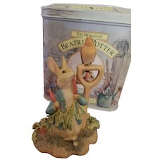 """Beatrix Potter figurine """"Peter Rabbit Eating a Radish"""" with Collector Tin"""