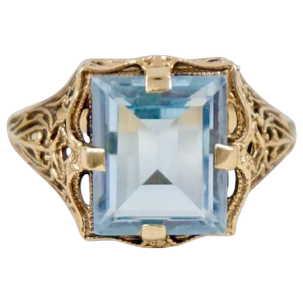 Art Deco Yellow Gold Filigree 3.5 CT Blue Topaz Ring 9 Karat size 6.5
