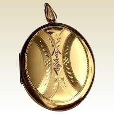 Vintage Gold Tone Metal Oval Double Photo Locket