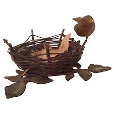 Vintage Metal Figurine Of A Bird Sitting On Side Of Bird Nest