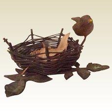 Vintage Metal Figurine Of A Bird Sitting On Side Of Bird Nest
