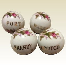 Vintage Set Of Four Hand Painted Porcelain Liquor Bottle Stoppers